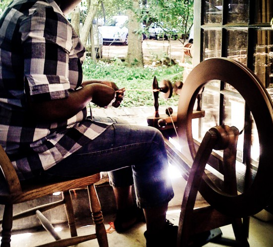 Zinzi at the spinning wheel