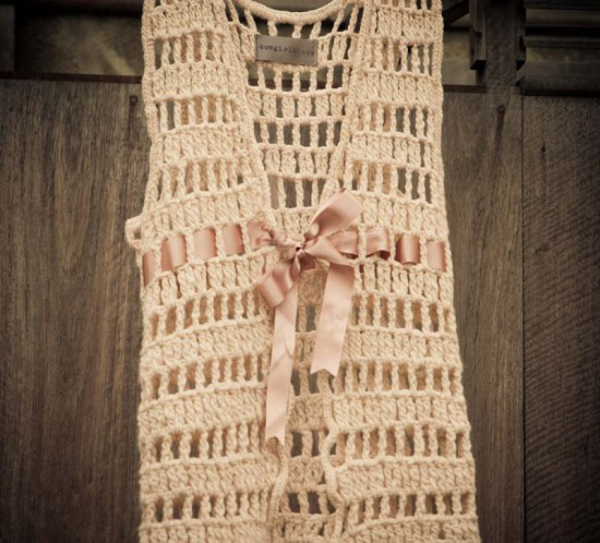 Hand-spun wool vest crocheted in an open weave with adjustable (and detachable) ribbon tie
