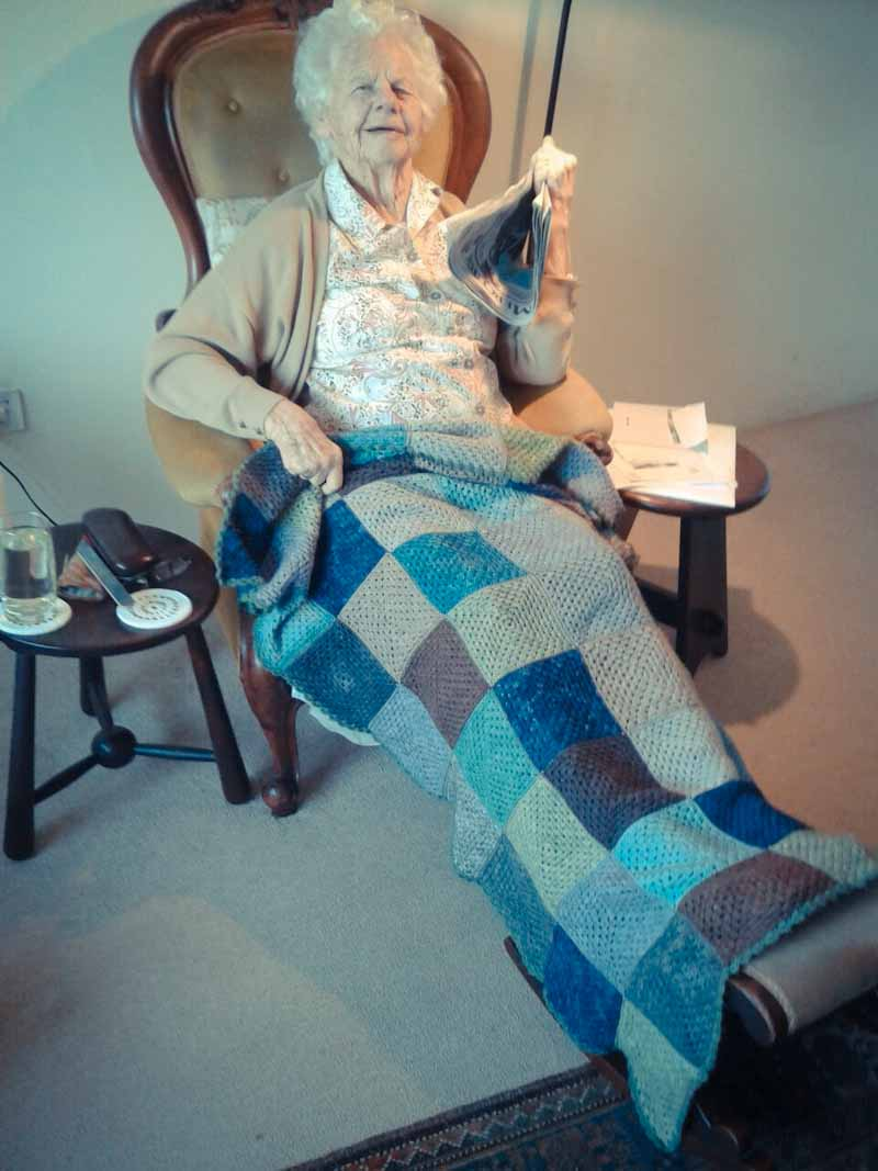 My grandmother with her crochet knee rug