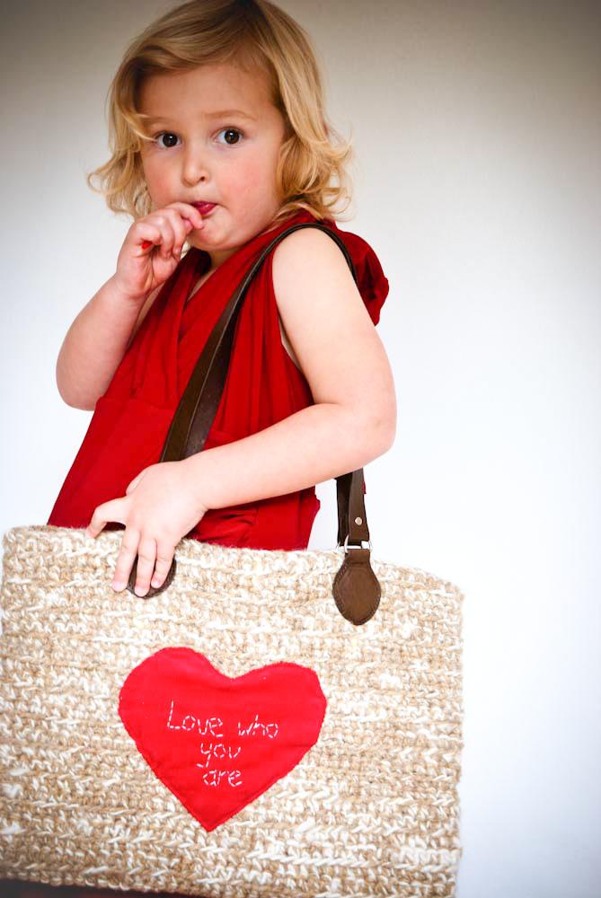 Young girl carring an oversize crochet handbag
