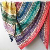 Rainbow striped hand knit triangle shawl in Cowgirlblues Merino Twist yarn