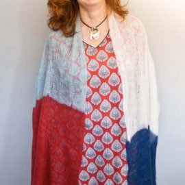 Bridget Henderson of Cowgirlblues wearing her hand knit pattern Kidsilk Cobweb Shawl