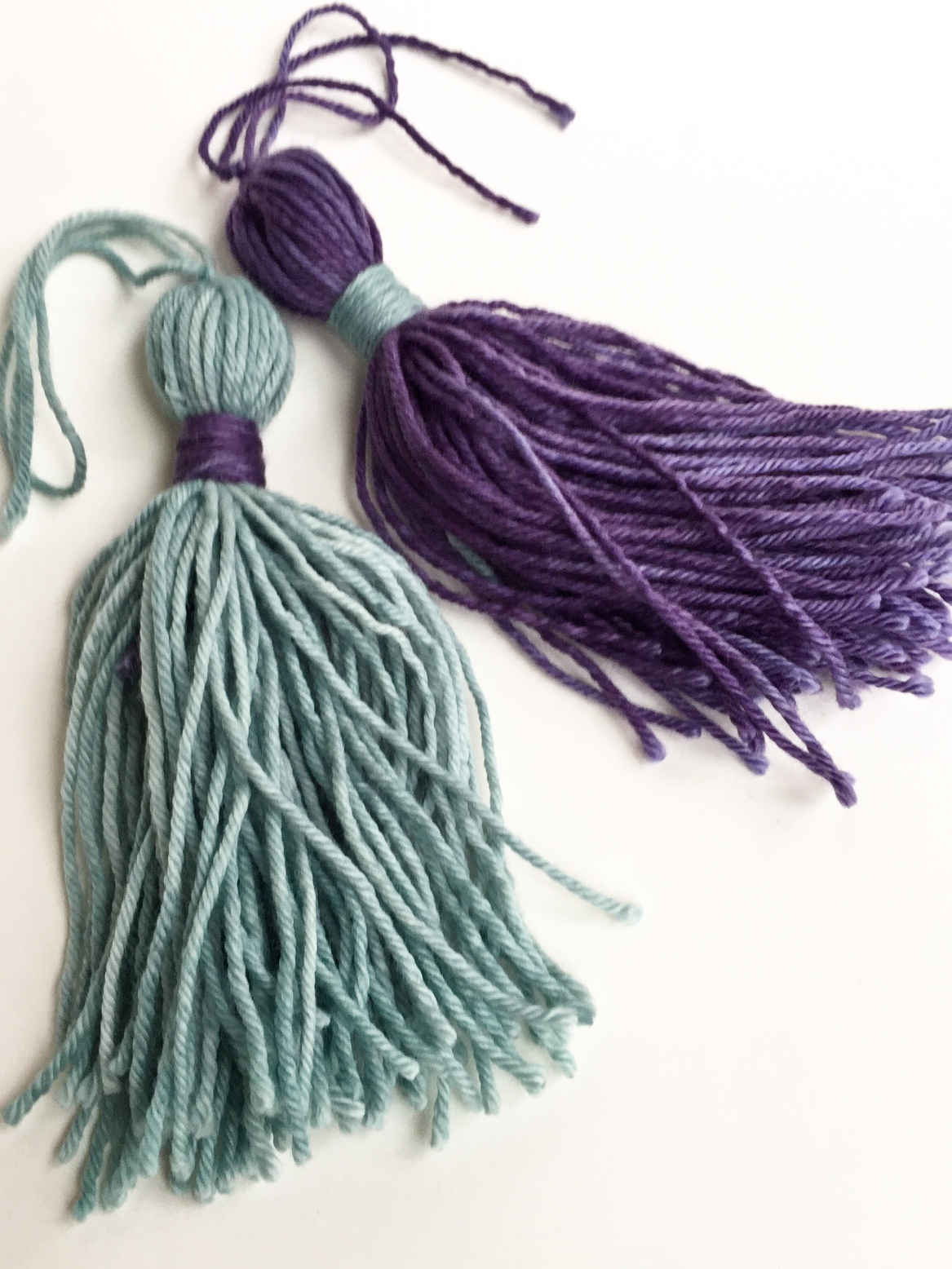 Hand made tassels in Celadon and Aubergine cowgirlblues Merino DK wool