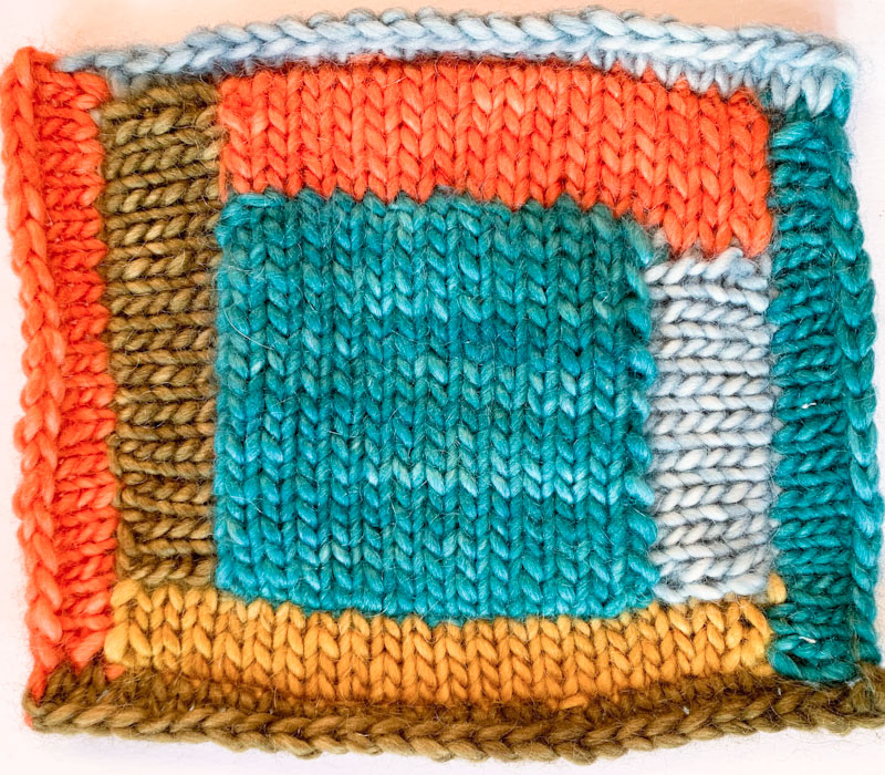 Log Cabin pattern knit square in different colours of Cowgirlblues Aran Single yarn