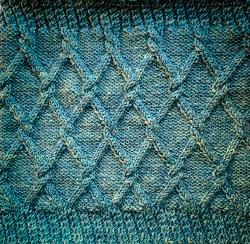 Trellis Cable hand knit in Cowgirlblues Merino DK
