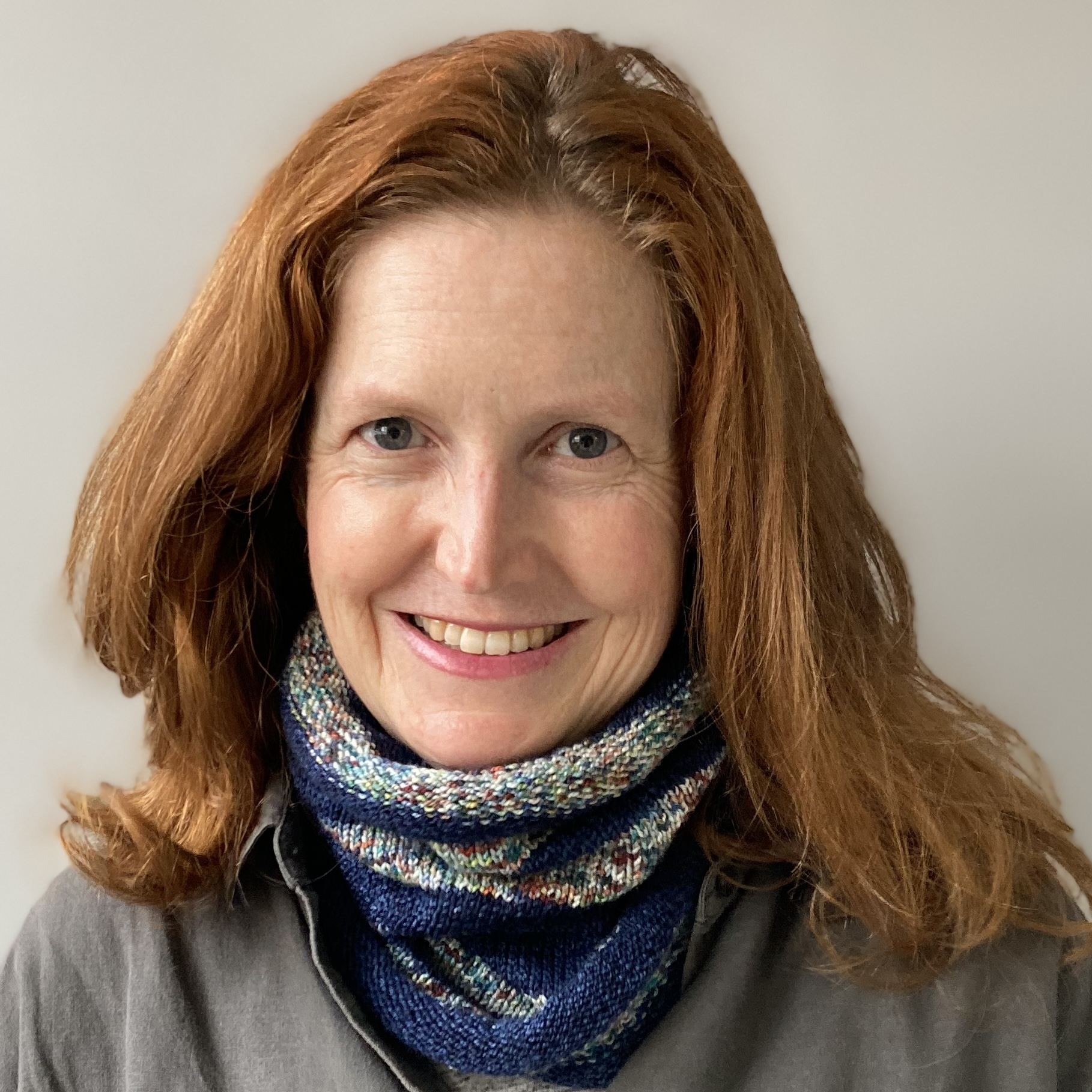Bridget Henderson wears a hand knit neckwarmer in Cowgirlblues Merino Twist Indigo Stripe colourway