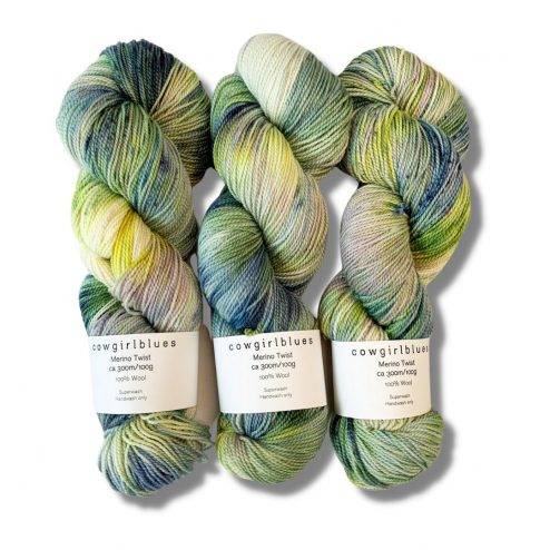 Three skeins of Cowgirlblues Merino Twist yarn dyed in shades of pale green, yellow and blue, but can you change this colour?